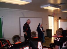 2003 Sr. Audrey praying with Springdale Football team vs. North Catholic