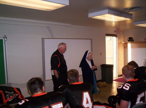 2003 Sr. Audrey praying with Springdale Football team vs. North Catholic
