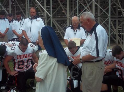 2011-09-02 Sr. Audrey praying with Springdale Football team vs. North Catholic